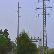 View of transmission substation through some trees