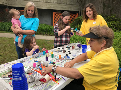 Adults and children doing a craft project
