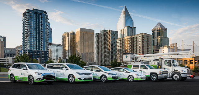 6 electric vehicles with charlotte skyline in background