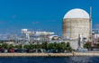Small image of Robinson Nuclear Plant exterior with lake in foreground