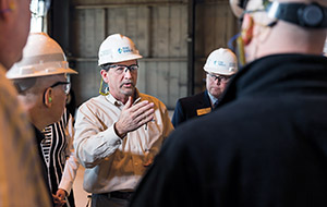 Photo of Duke Energy manager interacting with business executives.