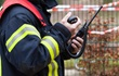 Emergency worker talking via two-way radio