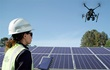 Duke Energy technician using a drone to inspect solar panels.