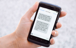 Mobile phone in hand with text messages on screen